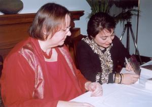 Shauna Singh Baldwin signing copy for Canadian HC